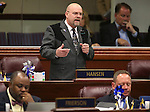 Nevada Assemblyman Ira Hansen, R-Sparks, speaks on the Assembly floor at the Legislative Building in Carson City, Nev., on Friday, May 24, 2013. Assembly Democrats Jason Frierson, left, and Mike Sprinkle are at front.<br /> Photo by Cathleen Allison