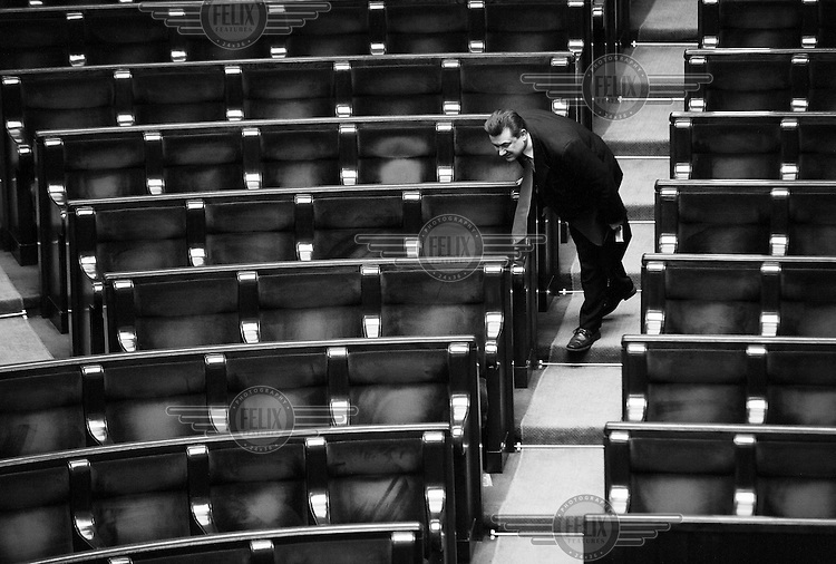 A member of parliament looking for his place on the first day of the new session in Sejm, the Polish parliament. .