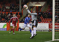 Jason Brown diving to save the shot from Danny Carmichael in the Aberdeen v Queen of the South William Hill Scottish Cup 5th Round match played at Pittodrie Stadium, Aberdeen on 4.2.12...