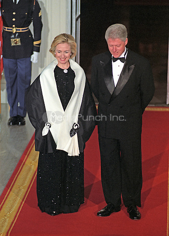 United States President Bill Clinton and first lady Hillary Rodham Clinton await the arrival of Prime Minister Keizo Obuchi and his wife, Chizuko Ono, of Japan on the North Portico of the White House for an Official Dinner in their honor at the White House in Washington, D.C. on May 3, 1999.  <br /> Credit: Ron Sachs / CNP/MediaPunch