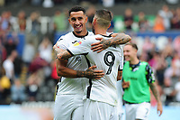 Courtney Baker-Richardson celebrates with Borja Baston of Swansea City at full time during the Sky Bet Championship match between Swansea City and Hull City at the Liberty Stadium in Swansea, Wales, UK. Saturday 03 August 2019