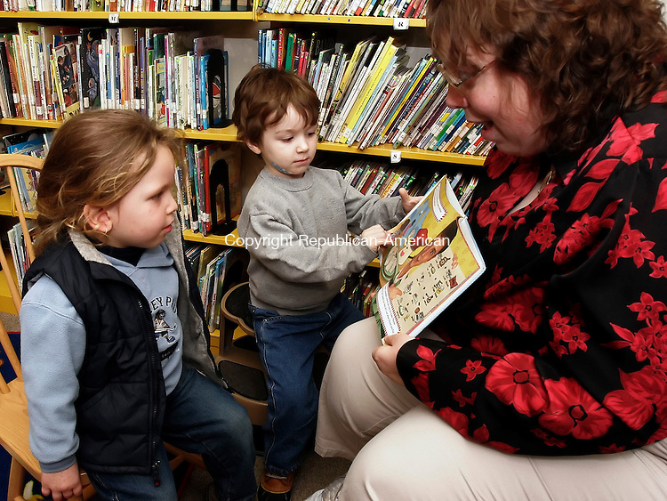 OXFORD, CT15 February 2006-021506TK02 (left to right:)  Dawn Higginson, Children's Liberian at the Oxford Public Library held a post-Valentine's day story time program Wednesday morning. Enjoying the story time are Noah Alberti and Nicholas Caruso, both 3.   Tom Kabelka / Republican-American (Noah Alberti, Nicholas Caruso, Dawn Higginson, Oxford Public Library)CQ