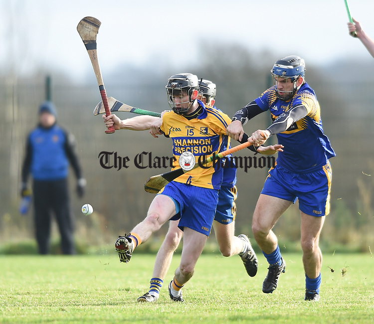 Alan Mulready of  Sixmilebridge  in action against James Mc Inerney of Newmarket during their Clare Champion Cup final at Clonlara. Photograph by John Kelly.