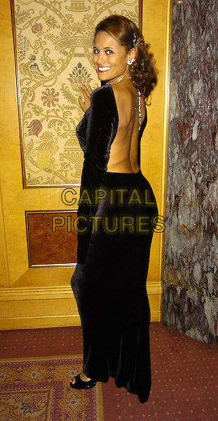 TROY TITUS-ADAMS.Gift Of Life VII Charity Dinner, Royal Lancaster Hotel, London, England, September 16th 2006..full length looking back behind over shoulder black dress.Ref: CAN.www.capitalpictures.com.sales@capitalpictures.com.©Can Nguyen/Capital Pictures