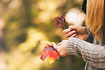 Pretty, young woman celebrating autumn and fall colors.