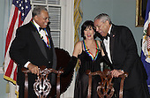 Actor James Earl Jones, left,  and theater actress Chita Rivera share a laugh with Secretary of State Colin Powell, right, before a group photo was taken of the 2002 Kennedy Center Honorees at the United States Department of State in Washington, D.C. on Saturday, December 7, 2002. . They are honored for their lifetime contributions to American culture through the performing arts..Credit: Robert Trippett - Pool via CNP