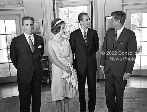 United States President John F. Kennedy, right, meets with Prince Juan Carlos of Spain, center right, and his wife, Princess Sophia of Greece, center left, and Ambassador of Spain, Antonio Garrigues y D&iacute;az-Ca&ntilde;abate, left, in the Oval Office of the White House in Washington, DC on August 30, 1962.<br /> Credit: Arnie Sachs / CNP