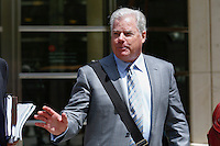 A lawyer for Arab Bank Plc, exits the Brooklyn Federal Court in Brooklyn, New York, 08-14-2014. Photo by VIEWpress