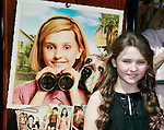 US actress Abigail Breslin stands next to herself in the poster as she arrives at the world premiere of 'Kit Kittredge: An American Girl' at the Grove in Los Angeles, California on 14 June 2008. The film is based on the American Girl doll line and centers on Kit Kittredge, a young woman who grows up in the early years of the Great Depression.