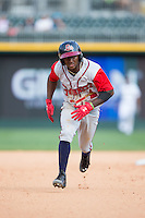 Ozzie Albies (2) of the Gwinnett Braves takes off for third base against the Charlotte Knights at BB&T BallPark on May 22, 2016 in Charlotte, North Carolina.  The Knights defeated the Braves 9-8 in 11 innings.  (Brian Westerholt/Four Seam Images)