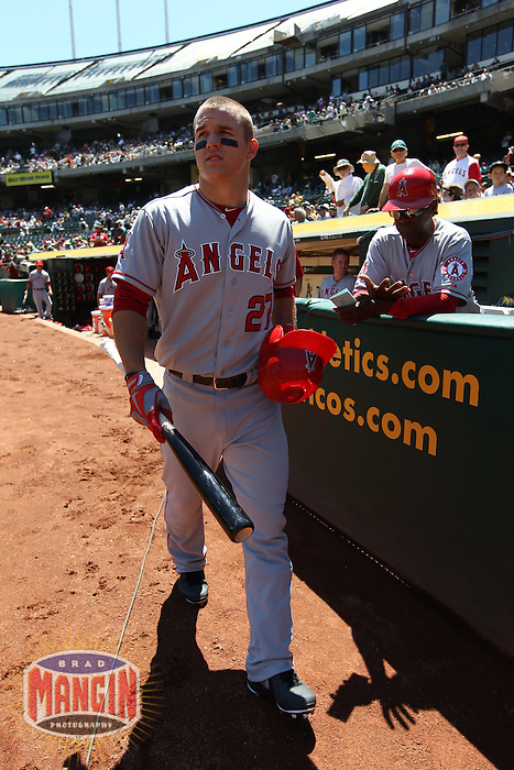 OAKLAND, CA - AUGUST 8:  Mike Trout of the Los Angeles Angels walks to the on deck circle before the game against the Oakland Athletics at O.co Coliseum on Wednesday, August 8, 2012 in Oakland, California. Photo by Brad Mangin