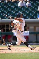 Micah Johnson (3) of the Charlotte Knights follows through on his swing against the Indianapolis Indians at BB&T BallPark on June 21, 2015 in Charlotte, North Carolina.  The Knights defeated the Indians 13-1.  (Brian Westerholt/Four Seam Images)
