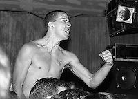 Racist skinhead charges the stage during Fugazi show at the Speedway Cafe.<br />