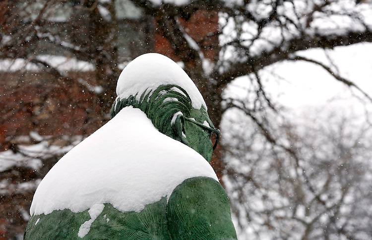 Snow coats the statue of Monsignor John Egan on the Lincoln Park campus of DePaul University in Chicago as the New Year brought two days of lake effect snow and ice. (Photo by Jamie Moncrief)