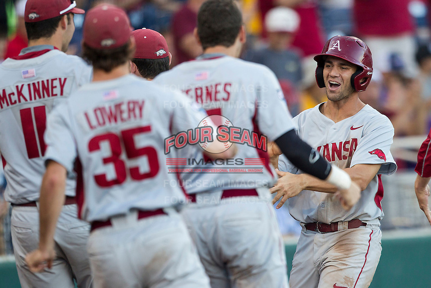 Arkansas Razorbacks outfielder Tyler Spoon (8) celebrates after scoring during the NCAA College baseball World Series against the Miami Hurricanes on June 15, 2015 at TD Ameritrade Park in Omaha, Nebraska. Miami beat Arkansas 4-3. (Andrew Woolley/Four Seam Images)