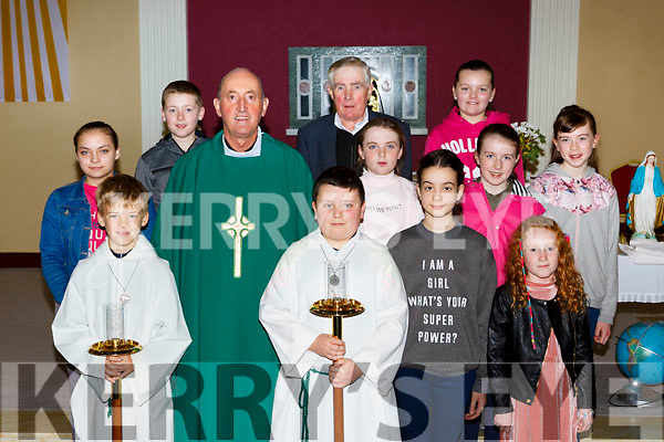 Fr Pat O'Donnell and the volunteers who participated in the 80th anniversary of the Church of the Holy Rosary in Gneeveguilla  on Sunday front row l-r: Gavin Barry, Padraig O'Brien, Ella O'Brien, Katie Clifford. Back row: Veronica Kobylinska, Stephen Dalton, Treasa Cremin, Donie O'Connor, Caillin O'Leary, Jennifer Dineen, Breda O'Brien