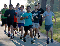 Graham Thomas/Siloam Sunday<br /> Members of the Siloam Springs boys cross country team start off down the bike trails on the campus of John Brown University during practice on Wednesday morning.