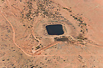 A dam and watering hole for cattle in the outback.