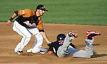 SIOUX FALLS, SD - MAY 18:  Corey Morales #4 from the Sioux Falls Pheasants puts the tag on Brandon Newton #2 from the Sioux City Explorers in the first inning of their game Friday night in Sioux Falls. (Photo by Dave Eggen/Inertia)