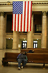 A black man sleeps at Union Station in Chicago, Sunday Oct 12 2008. Americans will go to the polls on Nov 4, at a time of great Financial crisis, war in Iraq and Afghanistan, to elect a  new President. A vote, that will affect not only America, but the whole world. Photo by Eyal Warshavsky .