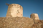 Two windmill ruins and stone walls, Pano Meria, Folegandros, Cyclades, Greece
