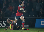 Outside centre Andrew Smith of Munster Rugby leaves Inside centre Ashley Smith of Newport Gwent Dragons on the floor as he runs forwards to score a try for Munster<br /> <br /> Guiness Pro 12<br /> Newport Gwent Dragons v Munster Rugby<br /> Rodney Parade<br /> 21.11.14<br /> &copy;Steve Pope-SPORTINGWALES