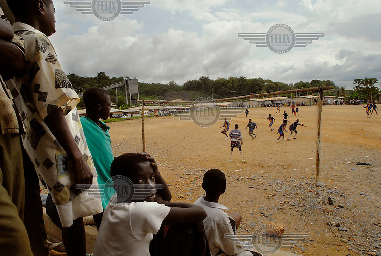 Youths watch a football match in the gold mining village of Anyinam.