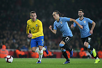 Arthur of Brazil tries to outpace Uruguay's Diego Laxalt during Brazil vs Uruguay, International Friendly Match Football at the Emirates Stadium on 16th November 2018