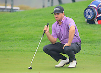Graeme McDowell (NIR) at the 1st green during Thursday's Round 1 of the 2014 BMW Masters held at Lake Malaren, Shanghai, China 30th October 2014.<br /> Picture: Eoin Clarke www.golffile.ie