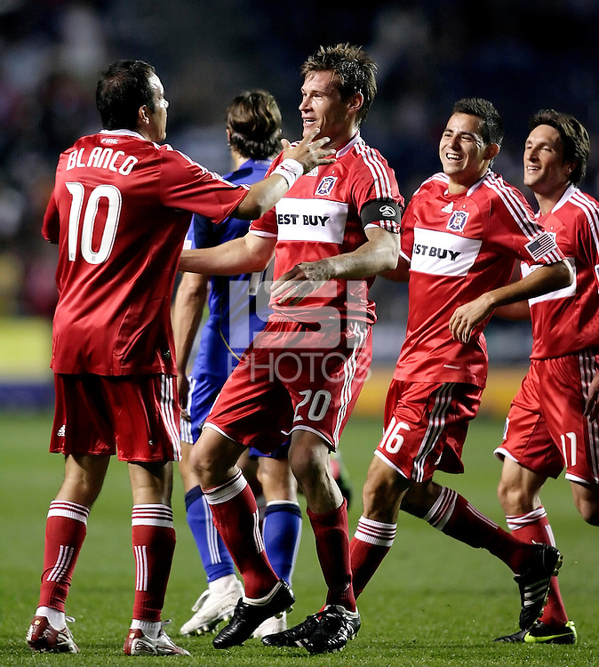 Chicago Fire forward Brian McBride (20) gets congratulates from midfielder Cuauhtemoc Blanco (10) after McBride headed the ball in the Kansas City goal off Blanco's free kick.  The Chicago Fire tied the Kansas City Wizards 2-2 at Toyota Park in Bridgeview, IL on April 18, 2009.