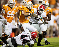 KNOXVILLE, TN - OCTOBER 5: Brian Maurer #18 of the Tennessee Volunteers is tackled by Travon Walker #44 and Azeez Ojulari #13 of the Georgia Bulldogs during a game between University of Georgia Bulldogs and University of Tennessee Volunteers at Neyland Stadium on October 5, 2019 in Knoxville, Tennessee.
