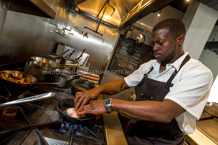 10/23/2015&mdash;Seattle, WA, USA<br /> <br /> Salare restaurant, owned by chef Edouardo Jordan, who is originally from St. Petersburg, Florida. <br /> <br /> Here Mr. Jordan prepares a main dish, &ldquo;Black cod &ldquo;Run Down&rdquo;, made with Black cod from the Makah tribe in Neah Bay, Washington, plantains, sweet corn, fushimi peppers, coconut milk and tostones.<br /> <br /> Salare is a chef-driven neighborhood restaurant, in the Ravenna neighborhood in North Seattle, that captures America&rsquo;s diverse culture of food with influences from America&rsquo;s South, Africa, Europe and the Caribbean Islands.<br /> <br /> Photograph by Stuart Isett<br /> &copy;2015 Stuart Isett. All rights reserved.