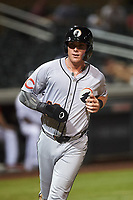 Glendale Desert Dogs Tyler Stephenson (36), of the Cincinnati Reds organization, jogs toward the dugout after scoring a run during an Arizona Fall League game against the Scottsdale Scorpions on September 20, 2019 at Salt River Fields at Talking Stick in Scottsdale, Arizona. Scottsdale defeated Glendale 3-2. (Zachary Lucy/Four Seam Images)