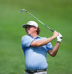 Jason Dufner takes his second shot on the eighth fairway during Round 3 of the CIMB Asia Pacific Classic 2011.  Photo © Raf Sanchez / PSI for Carbon Worldwide