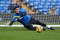 Thibaut Courtois of Chelsea warms up ahead of the Premier League match between Chelsea and Newcastle United at Stamford Bridge, London, England on 2 December 2017. Photo by David Horn.