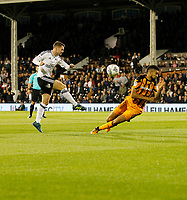 Oliver Norwood of Fulham has a shot charged down during the Sky Bet Championship match between Fulham and Hull City at Craven Cottage, London, England on 13 September 2017. Photo by Carlton Myrie.