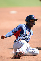 Cleveland Indians outfielder D'vone McClure (9) slides into third during an instructional league game against the Cincinnati Reds on September 28, 2013 at Goodyear Training Complex in Goodyear, Arizona.  (Mike Janes/Four Seam Images)