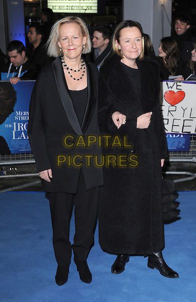 Phyllida Lloyd and Sarah Cooke.'The Iron Lady' European Film Premiere at BFI cinema, Southbank, London, England..4th January 2012.full length black suit jacket dress trousers arms linked couple .CAP/BEL.©Tom Belcher/Capital Pictures.