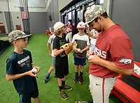 NWA Democrat-Gazette/ANDY SHUPE<br /> Arkansas center fielder Dominic Fletcher (right) signs autographs Friday, June 7, 2019, during practice in The Fowler Family Baseball and Track Training Center ahead of today's NCAA Super Regional game at Baum-Walker Stadium in Fayetteville. Visit nwadg.com/photos to see more photographs from the practice