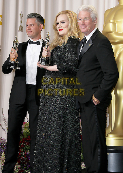 Paul Epworth, Adele (Adele Laurie Blue Adkins) & Richard Gere.85th Annual Academy Awards held at the Dolby Theatre at Hollywood & Highland Center, Hollywood, California, USA..February 24th, 2013.pressroom oscars half length trophies winners 3/4 full black dress tuxedo white shirt glasses side award trophy winner  beads beaded .CAP/ADM.©AdMedia/Capital Pictures.
