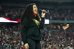 Entertainer Jordin Sparks performs the National Anthem before a Division Round playoff game between the Arizona Cardinals against the Green Bay Packers, Jan 16, 2016 in Glendale, Ariz. (Gene Lower via AP)