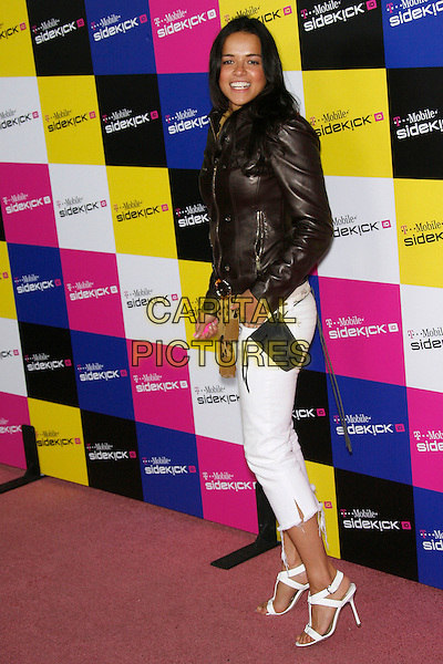 MICHELLE RODRIGUEZ.Attending the T-Mobile Sidekick iD Launch, .held at the T-Mobile Sidekick Lot,  Los Angeles, California, USA,13 April 2007..full length black leather jacket leopard print scarf belt white cropped trousers sandals shoes.CAP/ADM/ZL.©Zach Lipp/AdMedia/Capital Pictures.