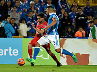BOGOTA - COLOMBIA - 20 – 05 - 2017: Andres Cadavid (Der.) jugador de Millonarios disputa el balón con Uvaldo Luna (Izq.) jugador de Patriotas F.C., durante partido de la fecha 19 entre Millonarios y por la Liga Aguila I-2017, jugado en el estadio Nemesio Camacho El Campin de la ciudad de Bogota. / Andres Cadavid (R) player of Millonarios vies for the ball with Uvaldo Luna (L) player of Patriotas F.C., during a match of the date 19th between Millonarios and Patriotas F.C., for the Liga Aguila I-2017 played at the Nemesio Camacho El Campin Stadium in Bogota city, Photo: VizzorImage / Luis Ramirez / Staff.