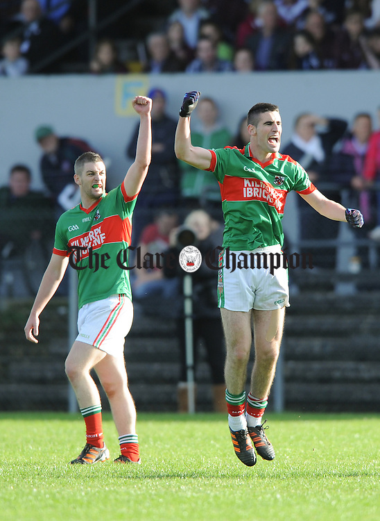 Kilmurry Ibrickane's Enda Coughlan and Niall Hickey celebrate a score during the senior county football final at Cusack park. Photograph by John Kelly.