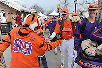 The Clemson Tiger mascot and fans slap hands with members of the Tigers baseball team in the first ever Tiger Walk as the team heads into the Reedy River Rivalry game against the South Carolina Gamecocks on March 1, 2014, at Fluor Field at the West End. South Carolina won, 10-2. (Tom Priddy/Four Seam Images)