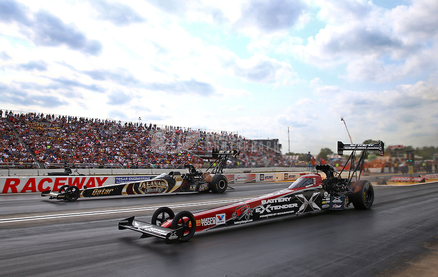 Aug. 18, 2013; Brainerd, MN, USA: NHRA top fuel dragster driver Spencer Massey (near) races alongside Khalid Albalooshi during the Lucas Oil Nationals at Brainerd International Raceway. Mandatory Credit: Mark J. Rebilas-