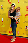 "SANTA MONICA, CA. - November 16: Actress Julie Bowen and son arrive at the 11th Anniversary Of P.S. Arts ""Express Yourself 2008"" at the Barker Hanger at the Santa Monica Airport on November 16, 2008 in Santa Monica, California."