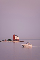 A boat passes the Round Island Lighthouse in Lake Huron at the Straits of Mackinac in Michigan.