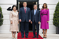 US President Donald J. Trump (C-L) and First Lady Melania Trump (R) welcome Korean President Moon Jae-in (C-R) and Mrs. Kim Jung-sook (L) to the South Portico of the White House in Washington, DC, USA, 11 April 2019. President Moon is expected to ask President Trump to reduce sanctions on North Korea in an attempt to jump start nuclear negotiations between North Korea and the US.<br /> CAP/MPI/RS<br /> ©RS/MPI/Capital Pictures
