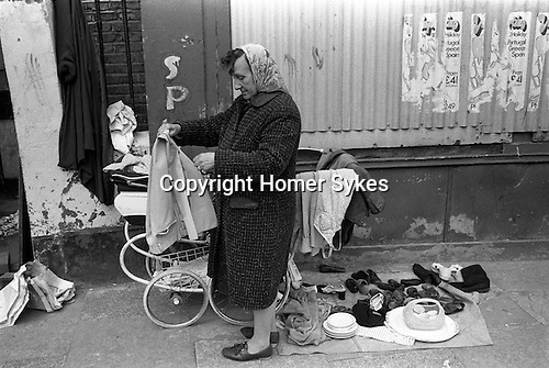 Woman selling old clothes from a pram. Whitechapel East London 1972
